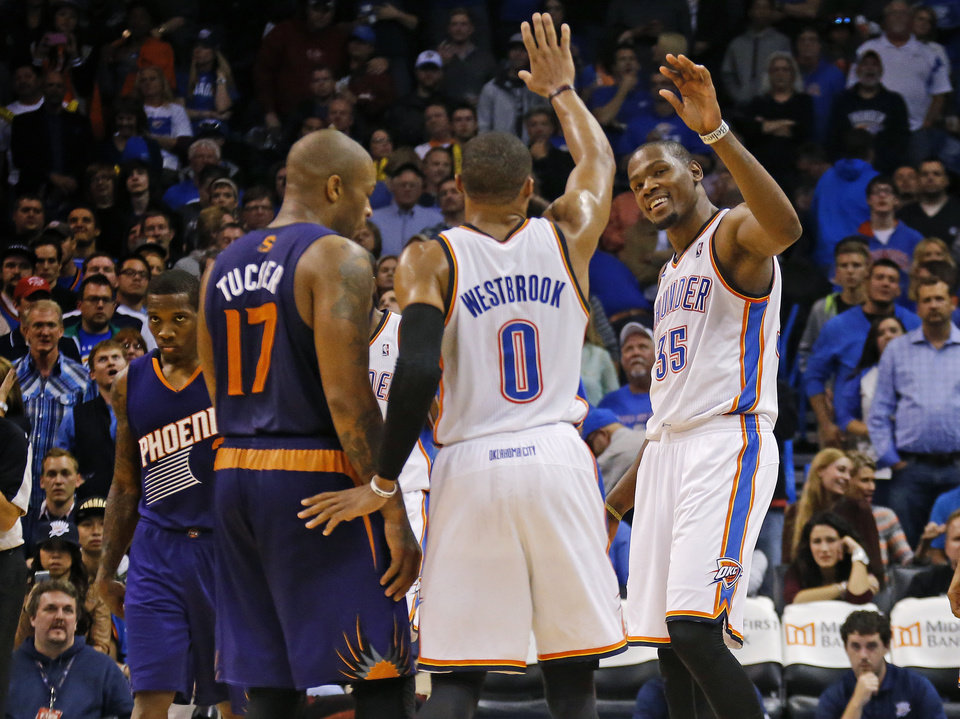 Oklahoma City Thunder small forward Kevin Durant (35) celebrates with Russell Westbrook during an NBA basketball game between the Oklahoma City Thunder and the Phoenix Suns at Chesapeake Energy Arena in Oklahoma City, Sunday, Nov. 3, 2013. Oklahoma City won 103-96. Photo by Bryan Terry, The Oklahoman