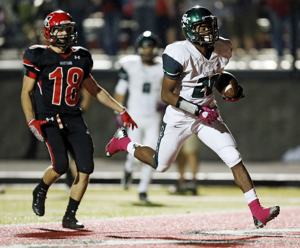 Edmond Santa Fe\'s Cameron Westbrook (20) scores a touchdown in front of Mustang\'s Sean Summers (18) during a high school football game between Mustang and Edmond Santa Fe in Mustang, Okla., Friday, Sept. 28, 2012. Photo by Nate Billings, The Oklahoman