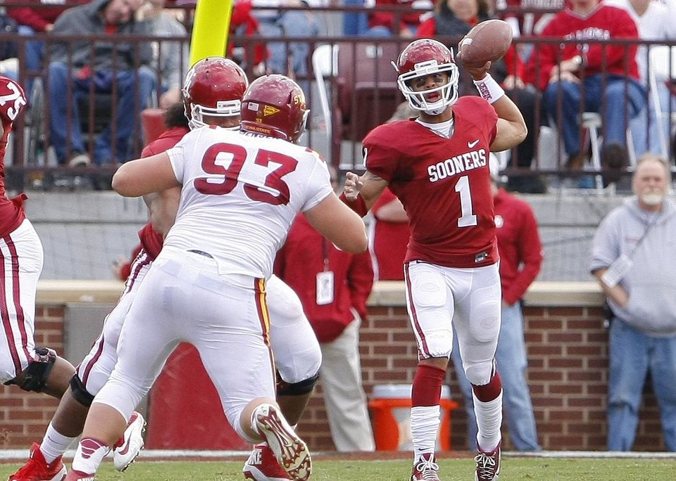 Photo - Oklahoma quarterback Kendal Thompson passes against Iowa State in the third quarter of an NCAA college football game in Norman, Okla. on Saturday, Nov. 16, 2013.  Oklahoma won 48-10. (AP Photo/Alonzo Adams)