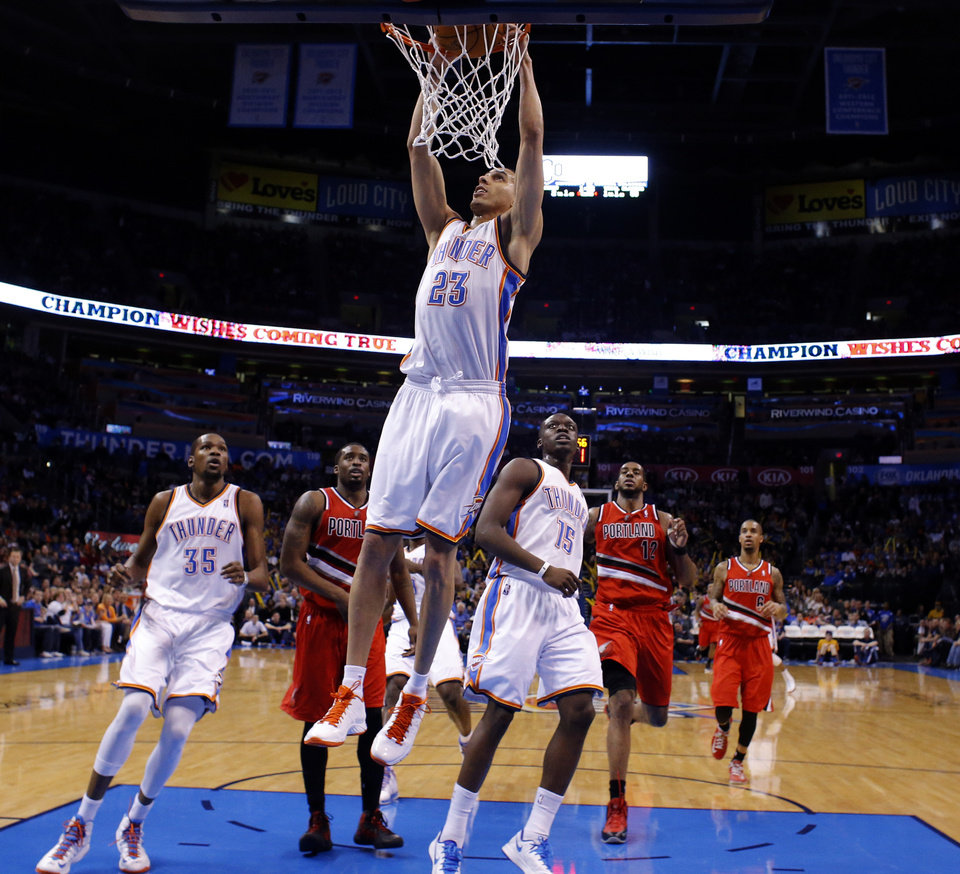 Oklahoma City\'s Kevin Martin (23) dunks the ball during the NBA basketball game between the Oklahoma City Thunder and the Portland Trail Blazers at the Chesapeake Energy Arena in Oklahoma City, Sunday, March, 24, 2013. Photo by Sarah Phipps, The Oklahoman