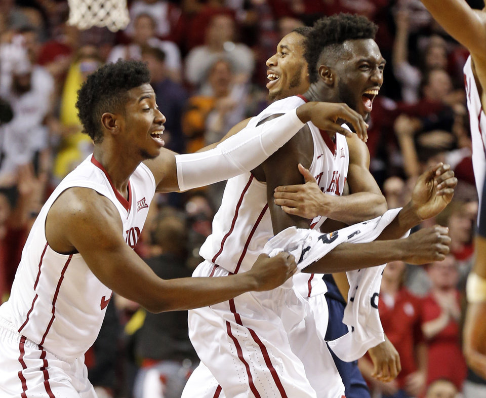 Photo - Oklahoma's Khadeem Lattin (12) gets the adulation Christian James (3) and Isaiah Cousins, back after a last second tip in for the win as the University of Oklahoma Sooner (OU) men defeat the West Virginia Mountaineers (WV) 70-68 in NCAA, college basketball at The Lloyd Noble Center on Jan. 16, 2016 in Norman, Okla. Photo by Steve Sisney, The Oklahoman