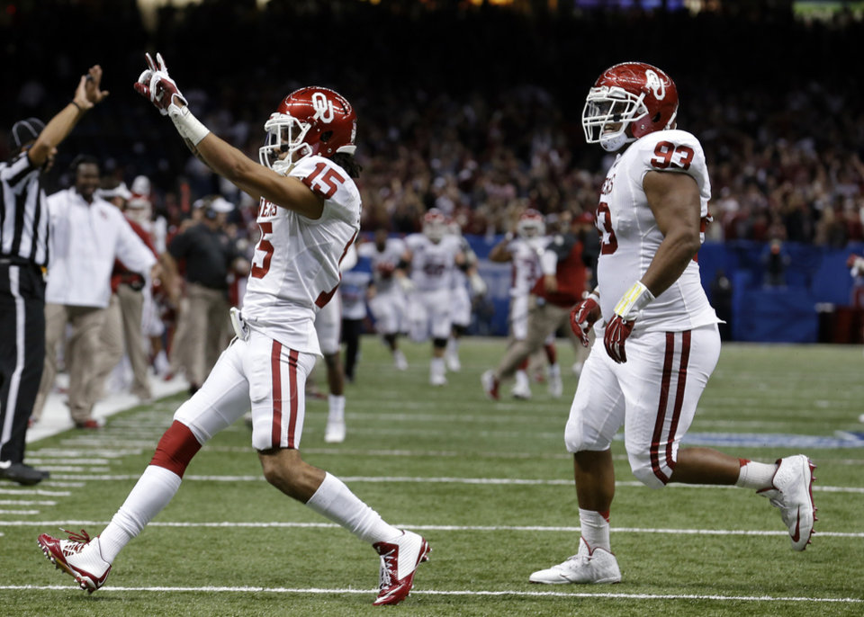 Oklahoma's Zack Sanchez (15) and Jordan Wade (93) celebrate during the NCAA football BCS Sugar Bowl game between the University of Oklahoma Sooners (OU) and the University of Alabama Crimson Tide (UA) at the Superdome in New Orleans, La., Thursday, Jan. 2, 2014.  .Photo by Sarah Phipps, The Oklahoman