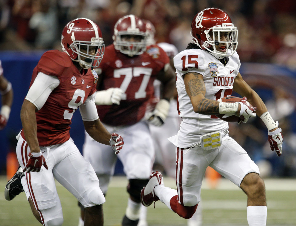 Photo -  Oklahoma's Zack Sanchez (15) returns a interception as Alabama's Amari Cooper (9) and Arie Kouandjio (77) chase him down during the NCAA football BCS Sugar Bowl game between the University of Oklahoma Sooners (OU) and the University of Alabama Crimson Tide (UA) at the Superdome in New Orleans, La., Thursday, Jan. 2, 2014.  Photo by Sarah Phipps, The Oklahoman