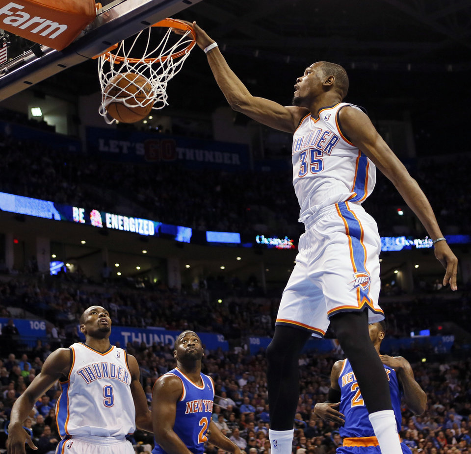 Oklahoma City's Kevin Durant (35) dunks the ball in front of Serge Ibaka (9), New York's Raymond Felton (2) and Iman Shumpert (21) during an NBA basketball game between the New York Knicks and the Oklahoma City Thunder at Chesapeake Energy Arena in Oklahoma City, Sunday, Feb. 9, 2014. Photo by Nate Billings, The Oklahoman