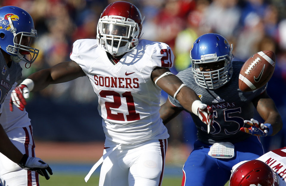 OU's Keith Ford (21) fumbles the ball in front of KU's Michael Reynolds (55) during the college football game between the University of Oklahoma Sooners (OU) and the University of Kansas Jayhawks (KU) at Memorial Stadium in Lawrence, Kan., Saturday, Oct. 19, 2013. Oklahoma won 34-19. Photo by Bryan Terry, The Oklahoman