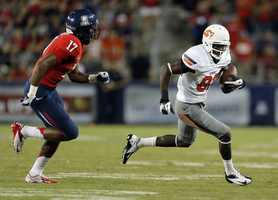 Photo - Oklahoma State's Tracy Moore (87) is chased down by Arizona's Derrick Rainey (17) during the college football game between the University  of Arizona and Oklahoma State University at Arizona Stadium in Tucson, Ariz.,  Saturday, Sept. 8, 2012. Photo by Sarah Phipps, The Oklahoman