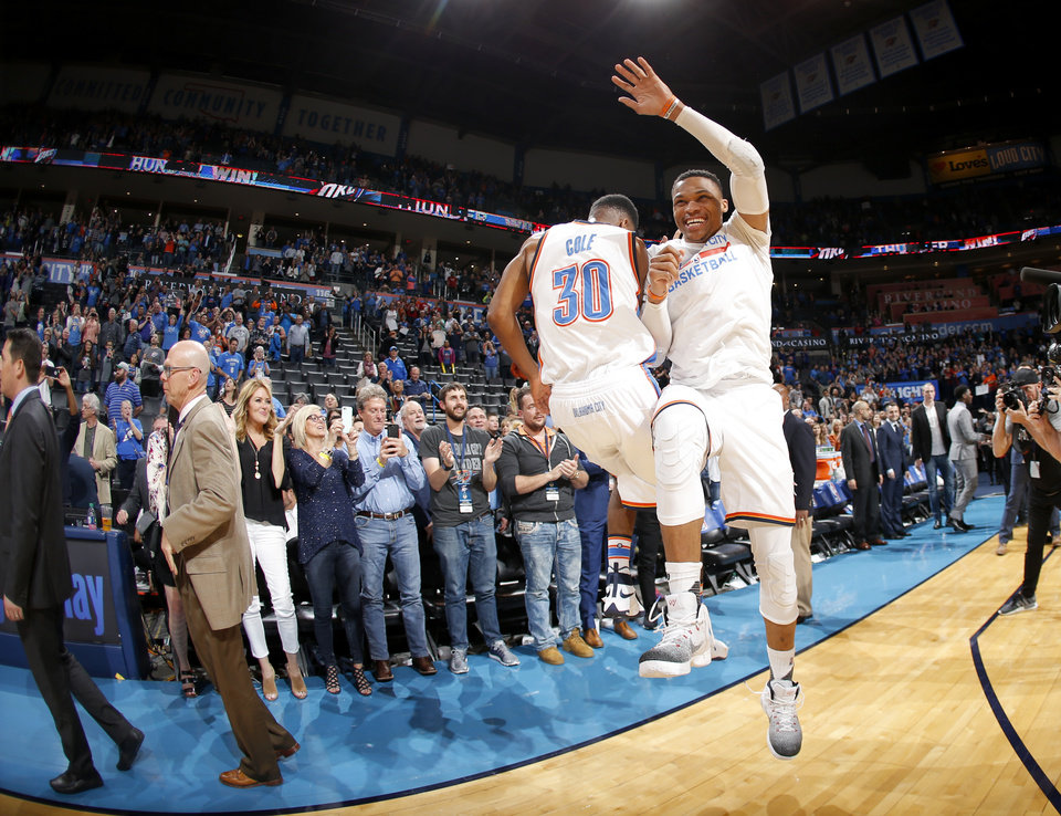 Photo - Oklahoma City's Russell Westbrook (0) celebrates with Norris Cole (30) after an NBA basketball game between the Oklahoma City Thunder and the Milwaukee Bucks at Chesapeake Energy Arena in Oklahoma City, Tuesday, April 4, 2017. Photo by Bryan Terry, The Oklahoman