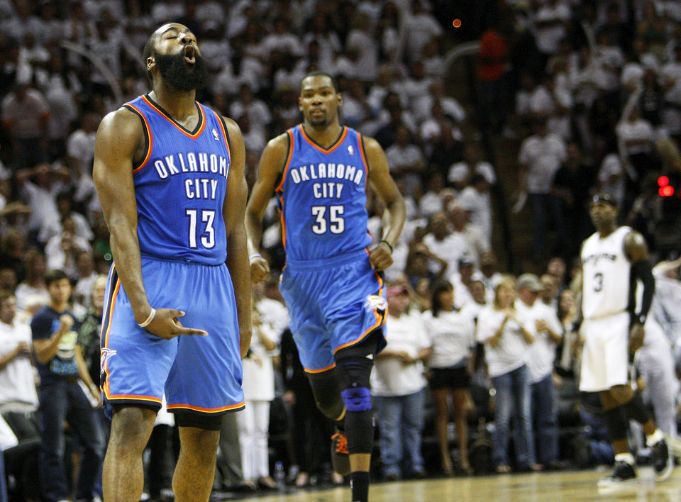 Photo - James Harden (13) reacts after making a 3-point shot late in the fourth quarter as Kevin Durant (35) runs to him to celebrate during Game 5 of the Western Conference Finals between the Oklahoma City Thunder and the San Antonio Spurs in the NBA basketball playoffs at the AT&T Center in San Antonio, Monday, June 4, 2012. The Thunder won, 108-103. Photo by Nate Billings, The Oklahoman