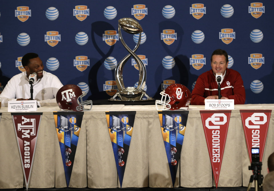Texas A&M head coach Kevin Sumlin, left, and Oklahoma head coach Bob Stoops share a laugh during a news conference leading up to the Cotton Bowl NCAA college football game Wednesday, Jan. 2, 2013, in Irving, Texas. Before Sumlin became a successful head coach, he was on Stoops' staff at Oklahoma. Before that, they were both assistant coaches recruiting the same area. Now Sumlin takes his Texas A&M team against Stoops' Sooners in a Jan. 4th Cotton Bowl matchup of former Big 12 rivals that are both 10-2. (AP Photo/LM Otero)