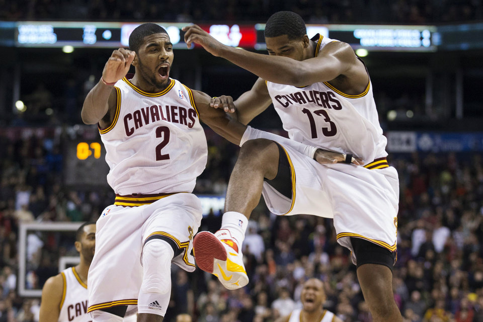 Cleveland Cavaliers' Kyrie Irving (2) celebrates with Tristan Thompson (13) after hitting a 3-pointer against the Toronto Raptors with 0.7 seconds left in the second half of an NBA basketball game, Saturday, Jan. 26, 2013, in Toronto. The Cavaliers won 99-98. (AP Photo/The Canadian Press, Chris Young)