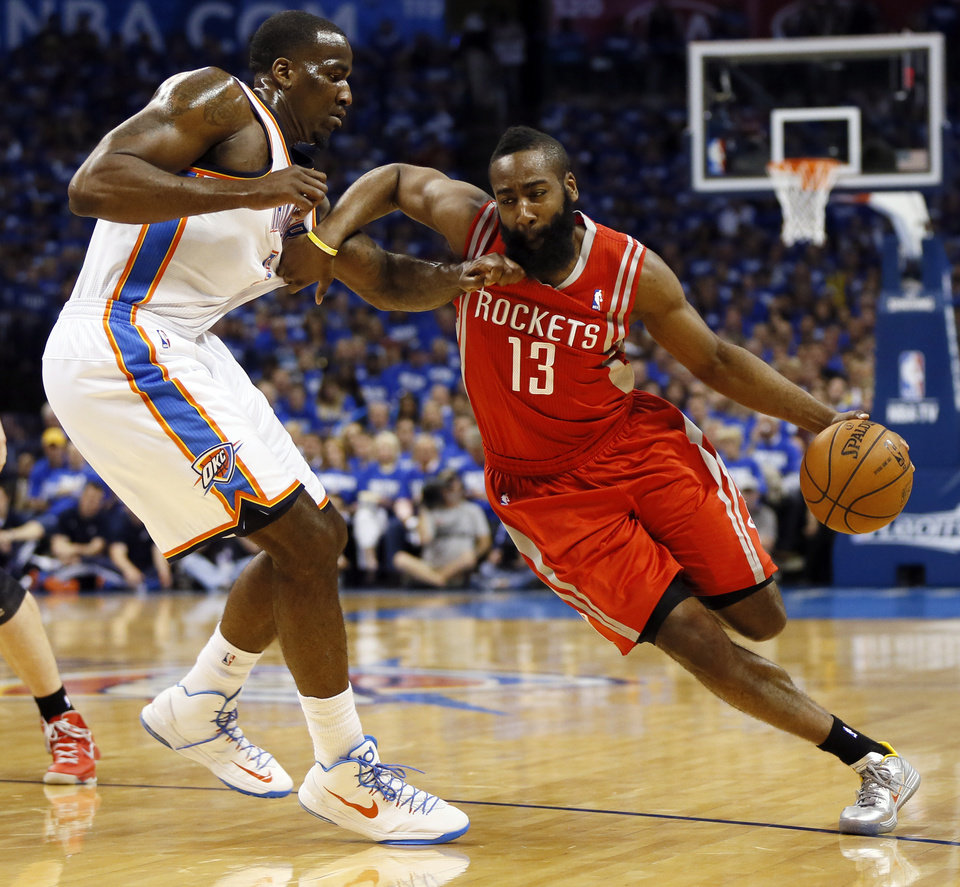 Photo - Houston's James Harden (13) drives against Oklahoma City's Kendrick Perkins during Game 1 in the first round of the NBA playoffs between the Oklahoma City Thunder and the Houston Rockets at Chesapeake Energy Arena in Oklahoma City, Sunday, April 21, 2013. Photo by Nate Billings, The Oklahoman