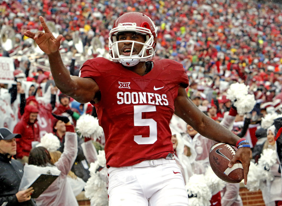 Photo - Oklahoma's Geno Lewis (5) celebrates a touchdown during the Bedlam college football game between the Oklahoma Sooners (OU) and the Oklahoma State Cowboys (OSU) at Gaylord Family - Oklahoma Memorial Stadium in Norman, Okla., Saturday, Dec. 3, 2016. Photo by Steve Sisney, The Oklahoman
