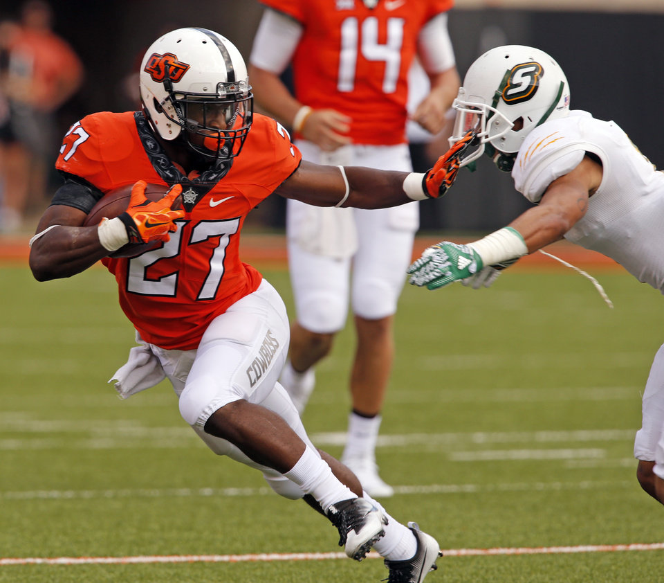 Photo - Oklahoma State's Justice Hill (27) runs in the first half during the college football game between the Oklahoma State Cowboys (OSU) and the Southeastern Louisiana Lions at Boone Pickens Stadium in Stillwater, Okla., Saturday, Sept. 12, 2015. Photo by Steve Sisney, The Oklahoman