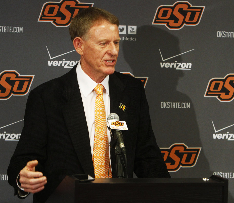 Photo - Oklahoma State athletic director Mike Holder addresses members of the media during a news conference in Stillwater, Okla., Sunday, Feb. 9, 2014, in regard to player Marcus Smart shoving a fan during an NCAA college basketball game the day before. Smart was suspended for three games by the Big 12. (AP Photo/The Oklahoman, KT King) LOCAL STATIONS OUT (KFOR, KOCO, KWTV, KOKH, KAUT OUT); LOCAL WEBSITES OUT; LOCAL PRINT OUT (EDMOND SUN OUT, OKLAHOMA GAZETTE OUT) TABLOIDS OUT