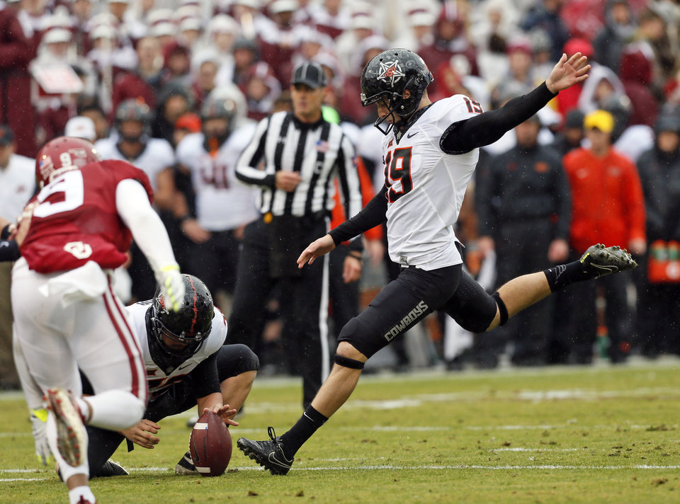 Photo - Oklahoma State's Ben Grogan (19) kicks a field goal in the first quarter during the Bedlam college football game between the Oklahoma Sooners (OU) and the Oklahoma State Cowboys (OSU) at Gaylord Family - Oklahoma Memorial Stadium in Norman, Okla., Saturday, Dec. 3, 2016. Photo by Nate Billings, The Oklahoman