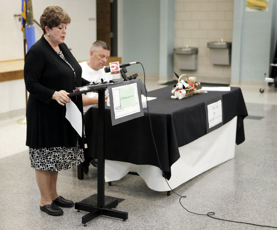 Photo - Susan Pierce, superintendent of Moore Public Schools, and Robert Romines, the incoming superintendent, held a news conference Monday to dispel a rumor about a teacher being fired for praying with her students during the May 20 tornado. Photo by KT King, The Oklahoman  KT King - The Oklahoman