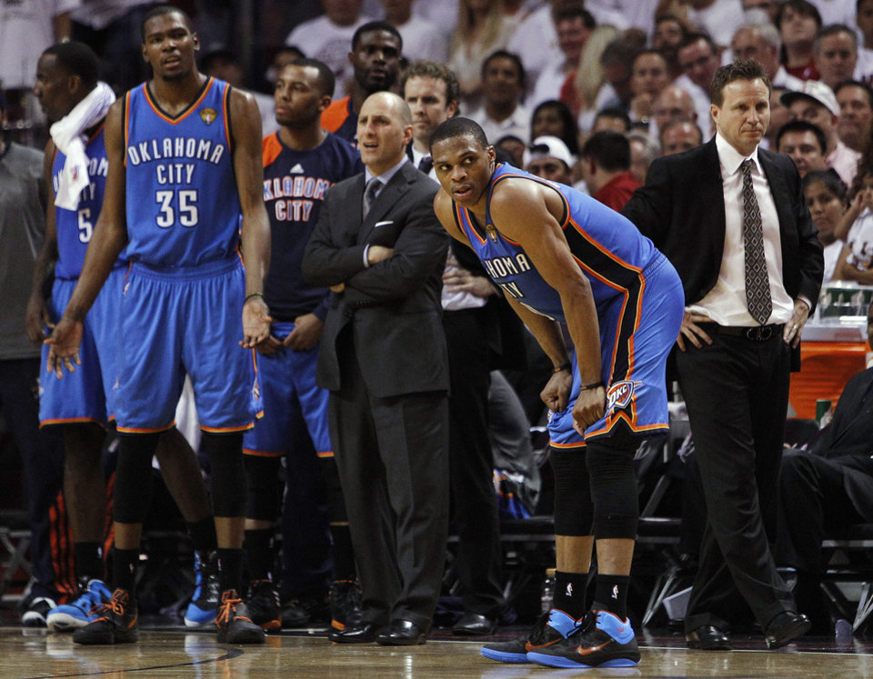 Oklahoma City Thunder players including Kevin Durant (35) and Russell Westbrook (0) react to a call during the second half at  Game 5 of the NBA finals basketball series against the Miami Heat, Thursday, June 21, 2012, in Miami. (AP Photo/Lynne Sladky) ORG XMIT: NBA154