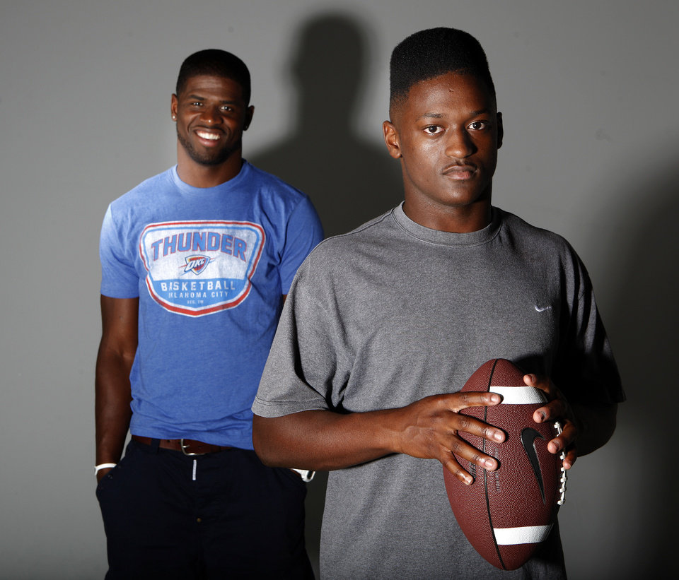 Photo - Carolina Panthers DB and former OU player Reggie Smith, left,  poses with his brother Trevan in the OPUBCO studios, Thursday, June 21, 2012. Photo by Sarah Phipps, The Oklahoman  SARAH PHIPPS - SARAH PHIPPS