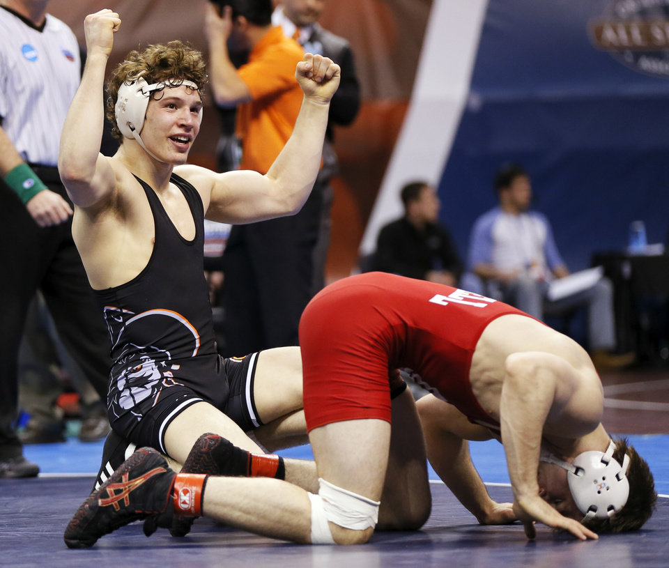 Photo - OSU's Alex Dieringer, left, celebrates after beating Cornell's Brian Realbuto in a 157-pound semifinal during the 2014 NCAA Div. I Wrestling Championships at Chesapeake Energy Arena in Oklahoma City, Friday, March 21, 2014. Photo by Nate Billings, The Oklahoman