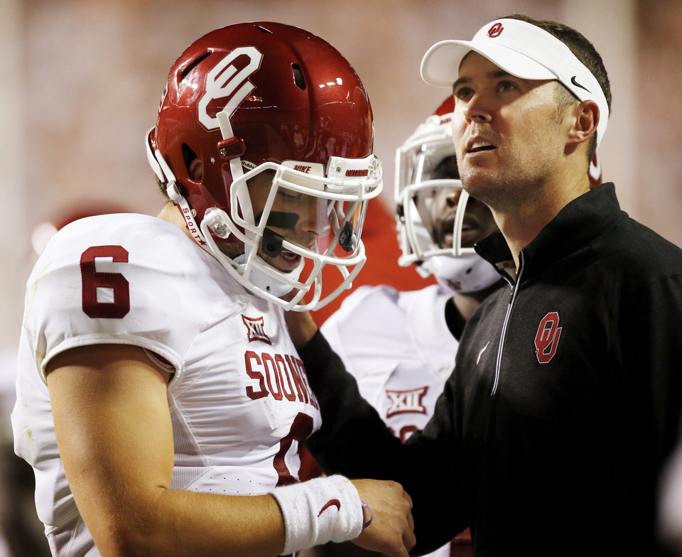 Photo - OU offensive coordinator Lincoln Riley puts his hand on quarterback Baker Mayfield's shoulder after Mayfield threw an interception during the college football game between the Oklahoma Sooners (OU) and the Tennessee Volunteers at Neyland Stadium in Knoxville, Tennessee, Saturday, Sept. 12, 2015. OU won 31-24 in double overtime. Photo by Nate Billings, The Oklahoman