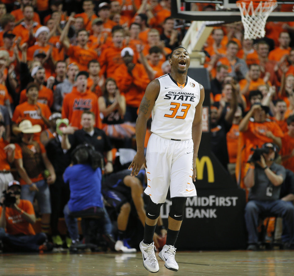 Photo - during an NCAA college basketball game between Oklahoma State and Memphis at Gallagher-Iba Arena in Stillwater, Okla., Tuesday, Nov. 19, 2013. Photo by Bryan Terry, The Oklahoman