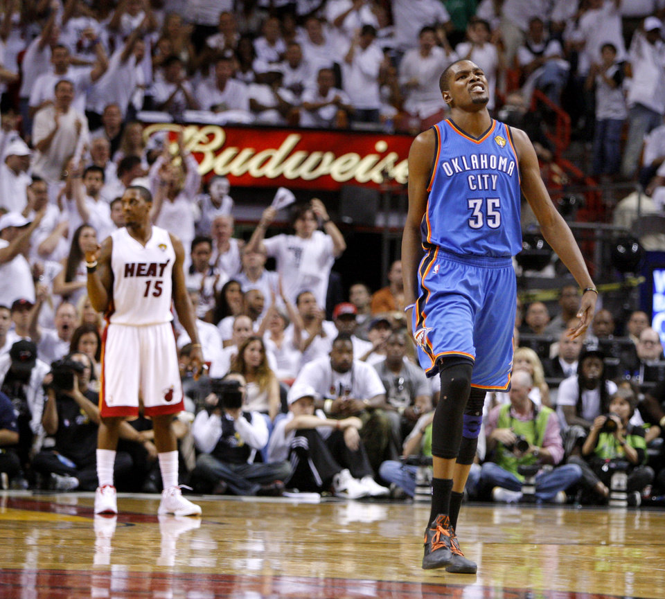 Photo - Oklahoma City's Kevin Durant (35) reacts in front of Miami's Mario Chalmers (15) during Game 3 of the NBA Finals between the Oklahoma City Thunder and the Miami Heat at American Airlines Arena, Sunday, June 17, 2012.  Oklahoma CIty lost 91-85.  Photo by Bryan Terry, The Oklahoman