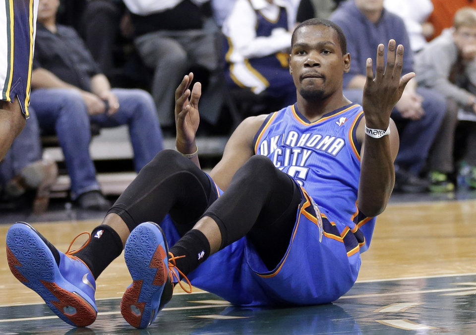 Photo -  Oklahoma City Thunder's Kevin Durant looks for a call after driving to the basket in the second quarter during an NBA basketball game against the Utah Jazz, Wednesday, Oct. 30, 2013, in Salt Lake City.  (AP Photo/Rick Bowmer)