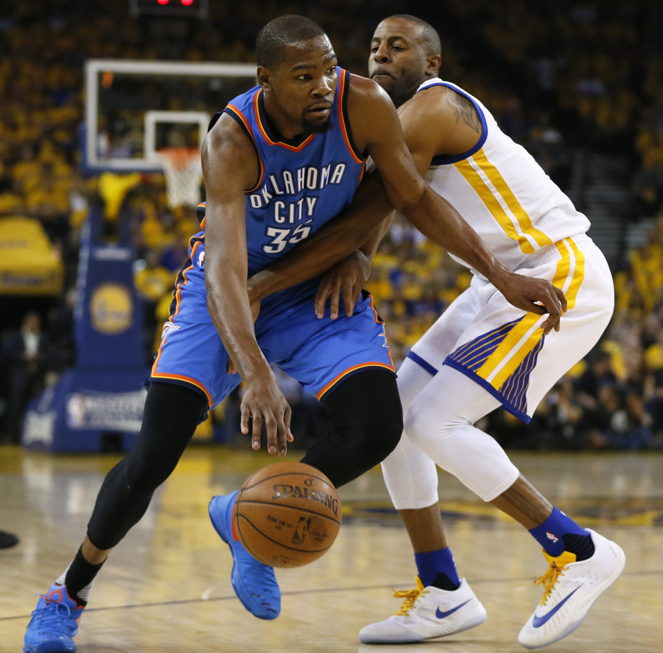 Photo - Oklahoma City's Kevin Durant (35) goes past Golden State's Andre Iguodala (9) during Game 2 of the Western Conference finals in the NBA playoffs between the Oklahoma City Thunder and the Golden State Warriors at Oracle Arena in Oakland, Calif., Wednesday, May 18, 2016. Photo by Nate Billings, The Oklahoman