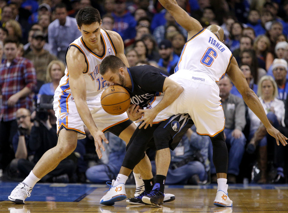 Photo - Minnesota's J.J. Barea (11) gets caught between Oklahoma City's Steven Adams (12) and Derek Fisher (6) during an NBA basketball game between the Oklahoma CIty Thunder and the Minnesota Timberwolves at Chesapeake Energy Arena in Oklahoma City, Wednesday, Feb. 5, 2014. Photo by Bryan Terry, The Oklahoman