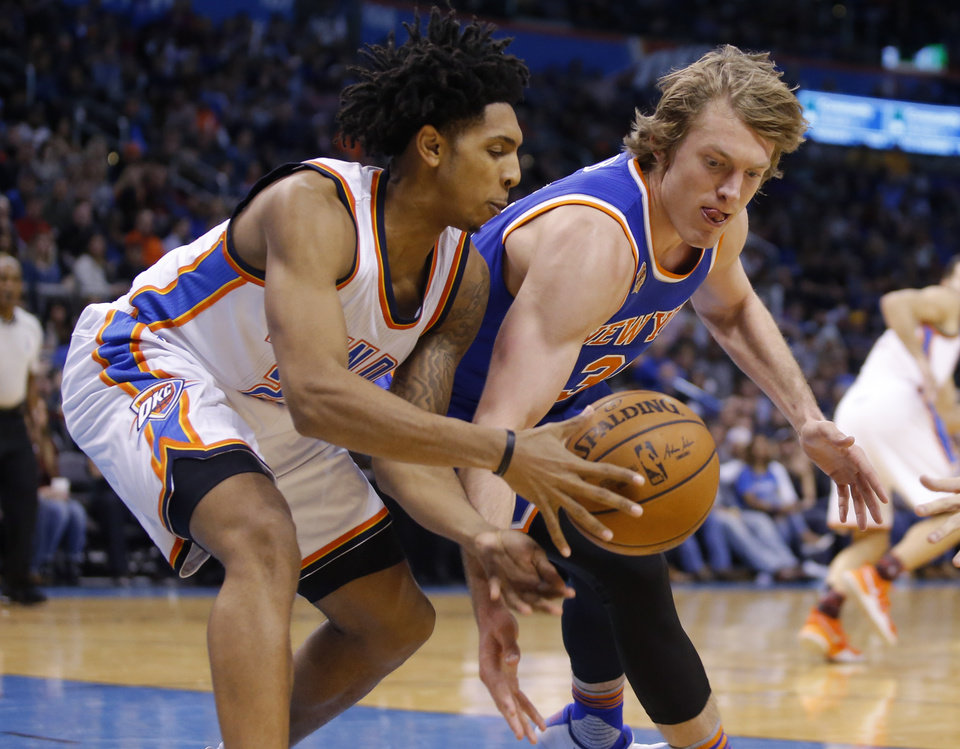 Photo - Cameron Payne battles the Knicks' Ron Baker for the ball in Payne's final game with the Thunder on Feb. 15. (Photo by Bryan Terry)