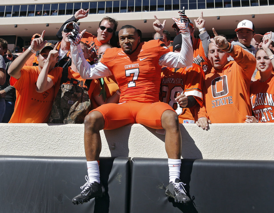 Oklahoma State's Shamiel Gary (7) celebrates with fans after the 24-10 win over TCU during a college football game between the Oklahoma State University Cowboys (OSU) and the Texas Christian University Horned Frogs (TCU) at Boone Pickens Stadium in Stillwater, Okla., Saturday, Oct. 19, 2013. Photo by Chris Landsberger, The Oklahoman