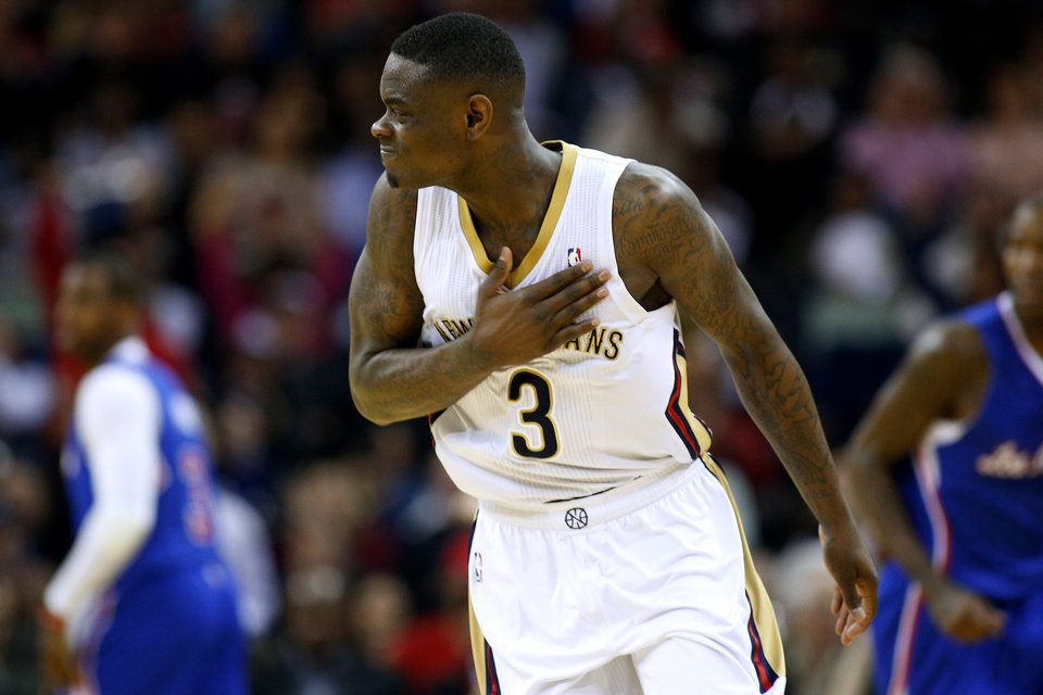 Photo - New Orleans Pelicans guard Anthony Morrow celebrates after a 3-point basket during the first half of an NBA basketball game against the Los Angeles Clippers in New Orleans, Wednesday, March 26, 2014. The Pelicans won 98-96. (AP Photo/Jonathan Bachman)