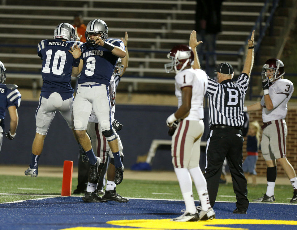 Photo - Edmond North's Chad Whiteley, left, and Luke Hoskins celebrate after Hoskins scored a touchdown against Edmond Memorial during a high school football playoff game at Wantland Stadium in Edmond, Okla., Thursday, Nov. 8, 2012. Photo by Bryan Terry, The Oklahoman