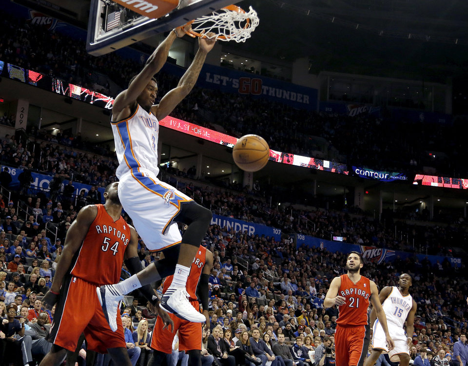 Oklahoma City\'s Perry Jones (3) dunks the ball during an NBA basketball game between the Oklahoma City Thunder and the Toronto Raptors at Chesapeake Energy Arena in Oklahoma City, Sunday, Dec. 22, 2013. Oklahoma City won 107-95. Photo by Sarah Phipps, The Oklahoman
