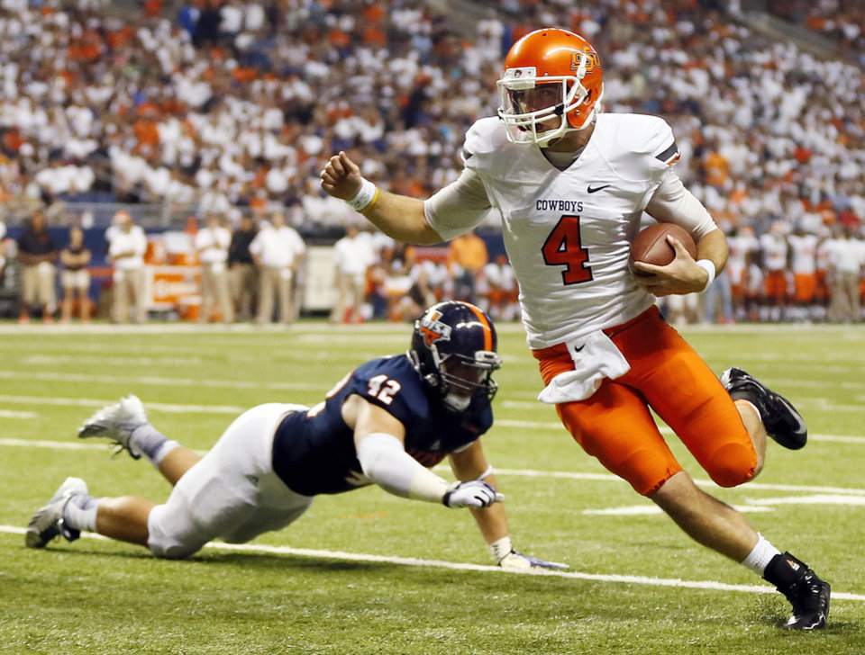 OSU quarterback J.W. Walsh (4) carries the ball past UTSA's Jens Jeters (42) on his way to a touchdown in the second quarter during a college football game between the University of Texas at San Antonio Roadrunners (UTSA) and the Oklahoma State University Cowboys (OSU) at the Alamodome in San Antonio, Saturday, Sept. 7, 2013.  Photo by Nate Billings, The Oklahoman