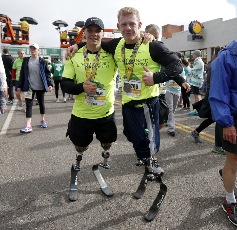 Photo -  Seth Alexander, left, and Trevor Bunch completed the half marathon at the Oklahoma City Memorial Marathon on Sunday. [PHOTO BY BRYAN TERRY, THE OKLAHOMAN]