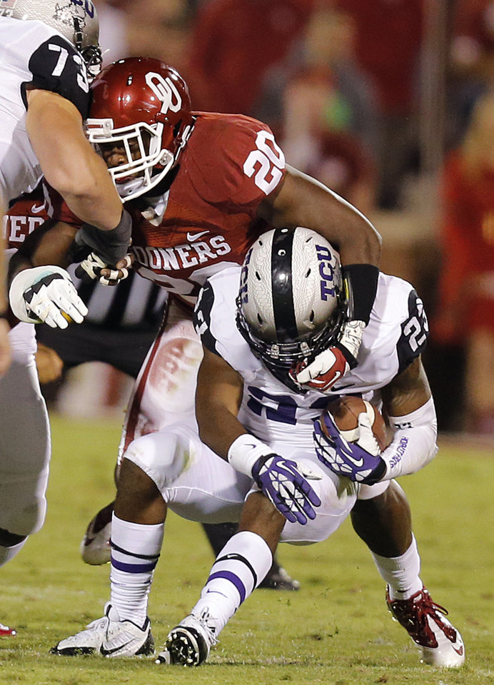 Oklahoma's Frank Shannon (20) stops TCU 's B.J. Catalon (23) during the college football game between the University of Oklahoma Sooners (OU) and the Texas Christian University Horned Frogs (TCU) at the Gaylord Family-Oklahoma Memorial Stadium on Saturday, Oct. 5, 2013 in Norman, Okla.   Photo by Chris Landsberger, The Oklahoman