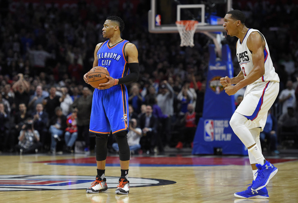 Photo - Los Angeles Clippers forward Wesley Johnson, right, celebrates after Oklahoma City Thunder guard Russell Westbrook stepped out of bounds to turn over the ball during the second half of an NBA basketball game, Wednesday, March 2, 2016, in Los Angeles. The Clippers won 103-98. AP Photo/Mark J. Terrill)