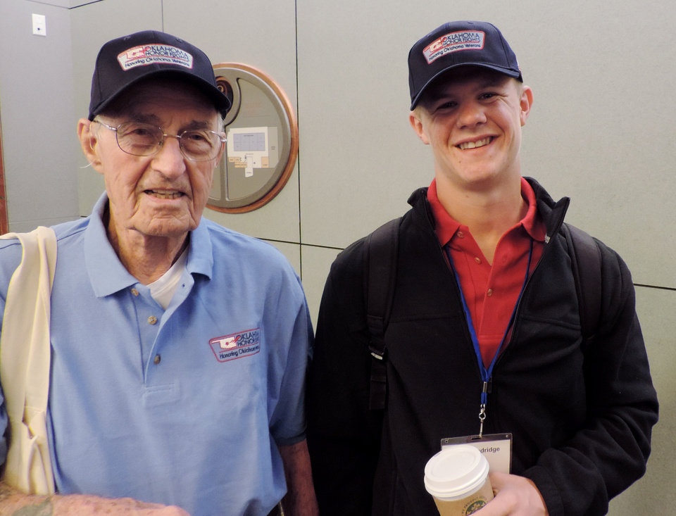 Photo -  Jake Standridge, a quarterback for Lindsay High School, accompanied his great-grandfather, Navy veteran Arthur Gruber, of Norman, on Wednesday on the Oklahoma Honor Flights trip to Washington, D.C. Photos by Bryan Painter, The Oklahoman   Bryan Painter