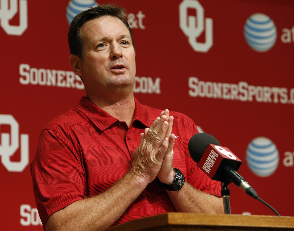 Head coach Bob Stoops addresses the media during media access day for the University of Oklahoma Sooner (OU) football team in the Adrian Peterson meeting room inside Gaylord Family-Oklahoma Memorial Stadium in Norman, Okla., on Saturday, Aug. 3, 2013. Photo by Steve Sisney, The Oklahoman
