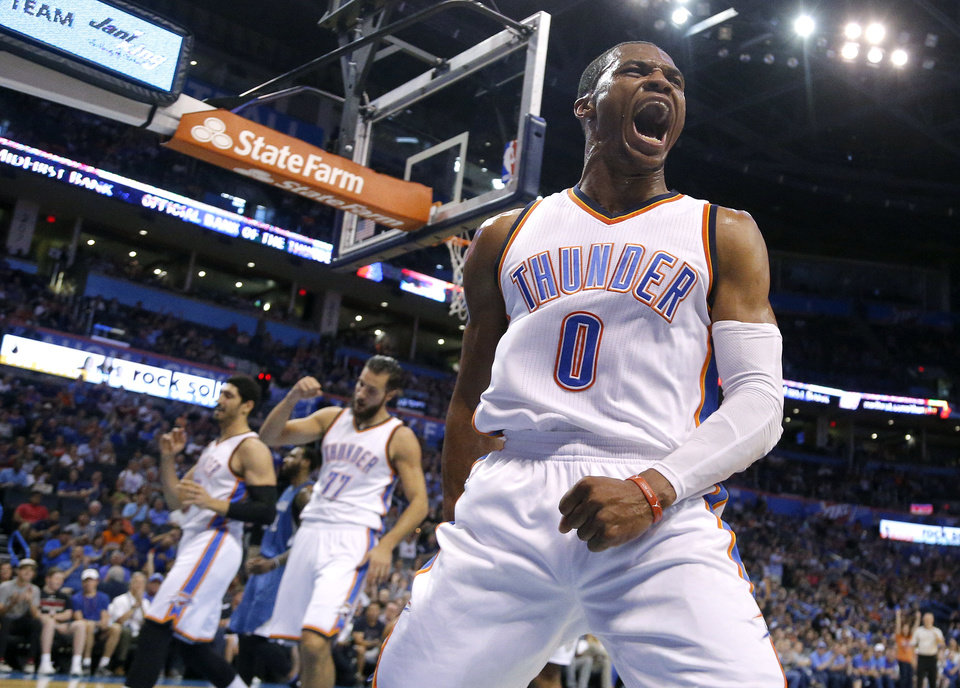 Photo - Oklahoma City's Russell Westbrook (0) celebrates a basket during the NBA game between the Oklahoma City Thunder and the Minnesota Timberwolves at the Chesapeake Energy Arena, Sunday, Oct. 16, 2016.   Photo by Sarah Phipps, The Oklahoman