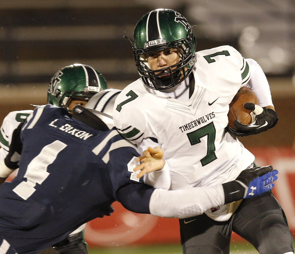 Photo - EN#4 Lance Dixon hits NN#7 QB John Kolar during the high school football game between Norman North and Edmond North in Edmond at Wantland Stadium Friday, Friday, October 18, 2013.  Photo by Doug Hoke, The Oklahoman