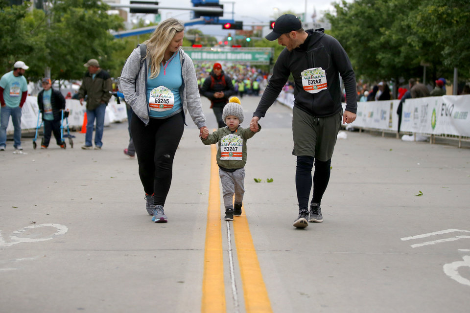Photo - Royce and Keri Young walk with their son Harrison, 2, during the children's marathon in the Oklahoma City Memorial Marathon in Oklahoma City, Sunday, April 30, 2017. Photo by Bryan Terry, The Oklahoman