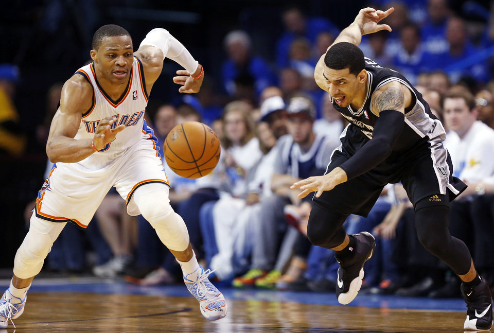 Photo - Russell Westbrook (0) chases the ball after stealing it from San Antonio's Danny Green (4) during Game 4 of the Western Conference Finals in the NBA playoffs between the Oklahoma City Thunder and the San Antonio Spurs at Chesapeake Energy Arena in Oklahoma City, Tuesday, May 27, 2014. Photo by Nate Billings, The Oklahoman