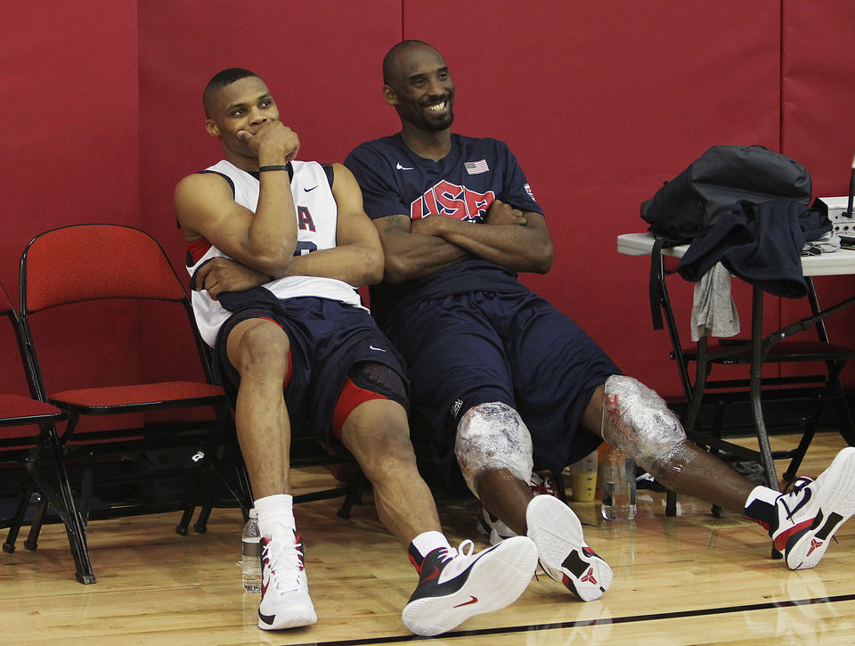 Photo - USA men's basketball national team members Russell Westbrook, left, hangs out with teammate Kobe Bryant after practice at the Mendenhall Center on the UNLV campus in Las Vegas on Friday, July 6, 2012. (AP Photo/Las Vegas Review-Journal, Jason Bean) ORG XMIT: NVLAS209