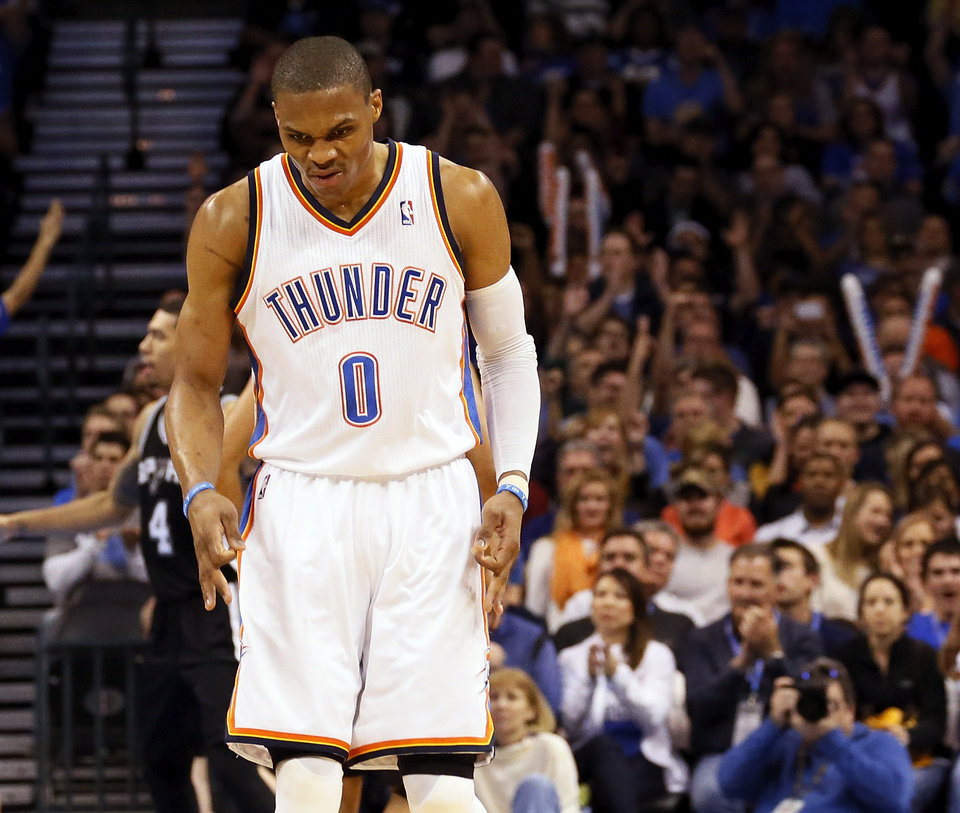 Oklahoma City's Russell Westbrook (0) reacts after hitting a 3-point shot during an NBA basketball game between the Oklahoma City Thunder and the San Antonio Spurs in Oklahoma City Monday, Dec. 17, 2012. Photo by Nate Billings, The Oklahoman