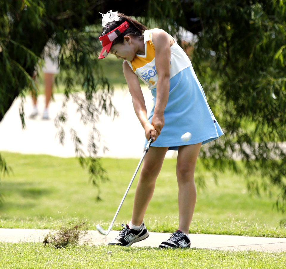 Photo - U.S. WOMEN'S AMATEUR PUBLIC LINKS CHAMPIONSHIP GOLF TOURNAMENT: Lucy Li, 10, hits her second shot on hole 10 during the USGA Women's Public Links championship at Jimmie Austin OU Golf Course on Tuesday, June 18, 2013, in Norman, Okla.  Photo by Steve Sisney, The Oklahoman