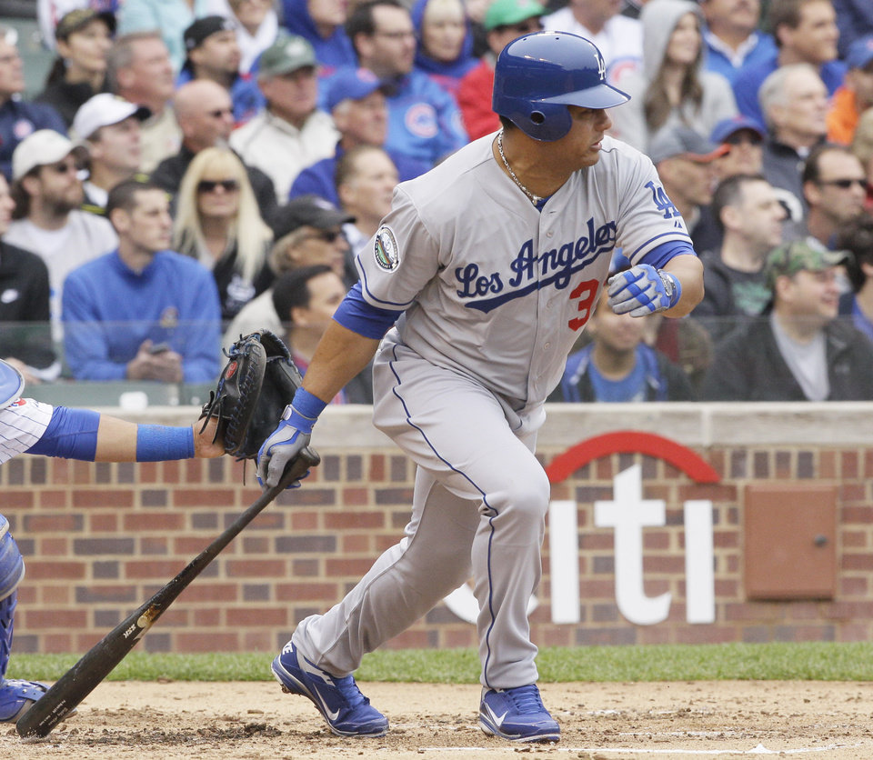 Los Angeles Dodgers' Bobby Abreu watches his double during the second inning of a baseball game against the Chicago Cubs in Chicago, Saturday, May 5, 2012. (AP Photo/Nam Y. Huh)