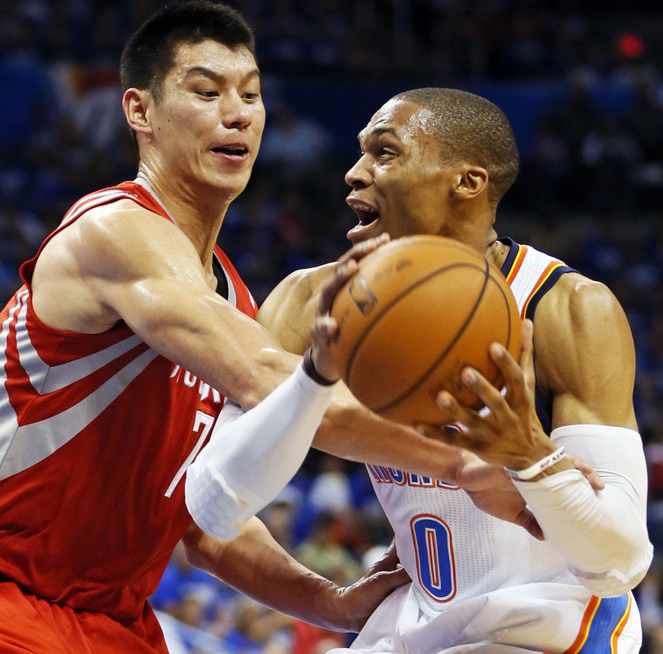 Photo - Houston's Jeremy Lin (7) fouls Oklahoma City's Russell Westbrook (0) during Game 1 in the first round of the NBA playoffs between the Oklahoma City Thunder and the Houston Rockets at Chesapeake Energy Arena in Oklahoma City, Sunday, April 21, 2013. Oklahoma City won, 120-91. Photo by Nate Billings, The Oklahoman