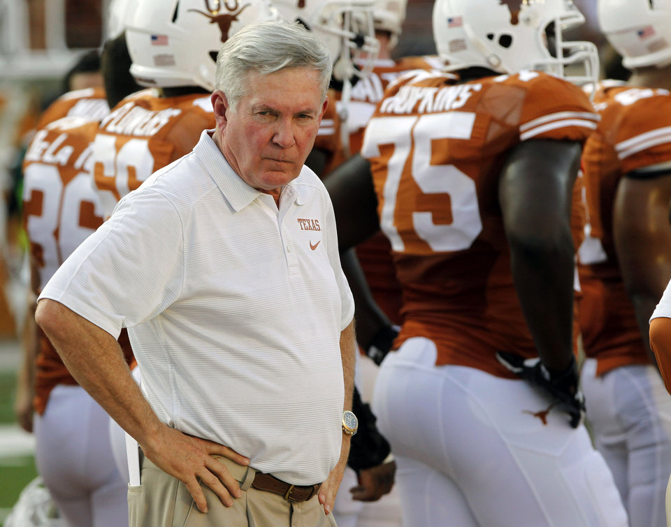 Texas head coach Mack Brown eyes his players' warmups before the start of an NCAA college football game against New Mexico State, Saturday Aug. 31, 2013, in Austin, Texas. (AP Photo/Michael Thomas) ORG XMIT: TXMT116